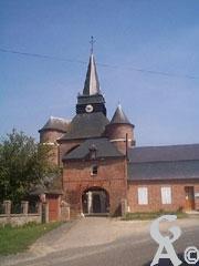 Le porche d'accès à l'église - M. Trannois