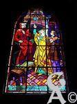 L'église - Vitrail évoquant le martyre de Jeanne d'Arc